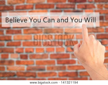 Believe You Can And You Will - Hand Pressing A Button On Blurred Background Concept On Visual Screen
