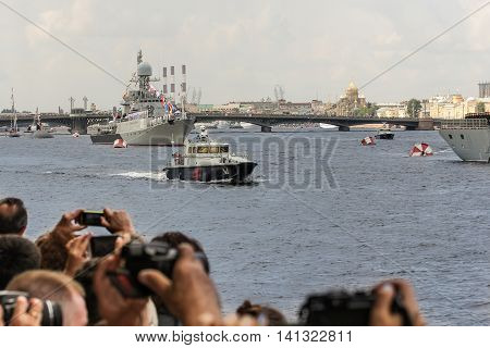 St. Petersburg, Russia - 31 July, People take pictures of military ships parade, 31 July, 2016. Festive parade of warships on the Neva River in St. Petersburg.