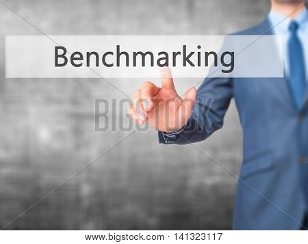 Benchmarking - Businessman Hand Pushing Button On Touch Screen