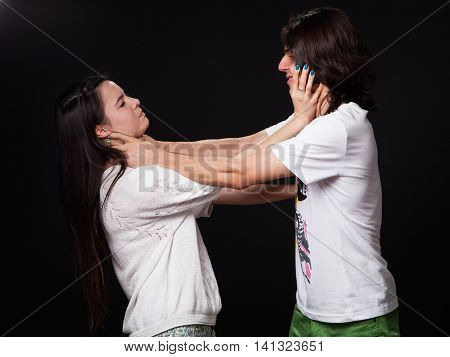 Domestic violence - husband and wife are fighting black background