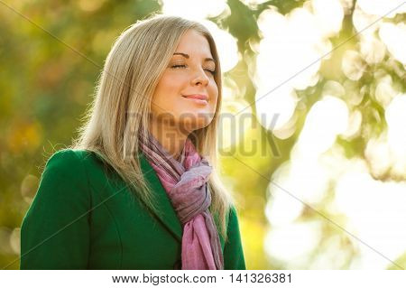 Young woman is enjoying fresh air in autumn.