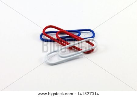 Paperclip for office desk with red blue white color.