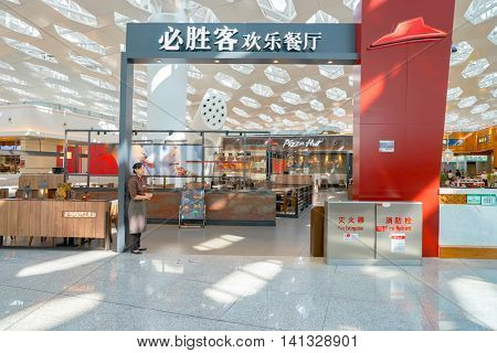 SHENZHEN, CHINA - MAY 11, 2016: Pizza Hut in Shenzhen Bao'an International Airport. Pizza Hut is an American restaurant chain and international franchise.