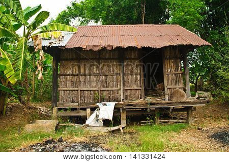 Thai ancient style house at countryside of Thailand