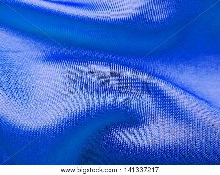 Blue satin textile or cloth, close-up of textile.