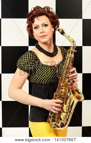 Beautiful saxophone player in retro style. Professional musician. Beat generation.