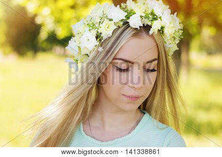 Young caucasian woman with blond hair and long eye lashes