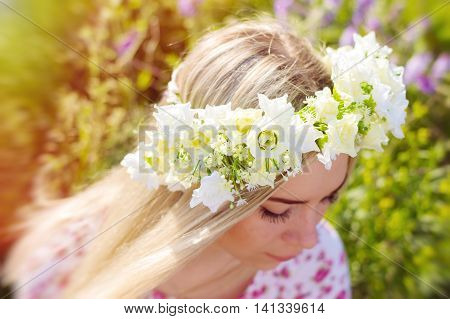Flower coronet on the head of a young blond girl