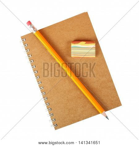 Stationery - School notebook eraser and graphite pencil on a white background.