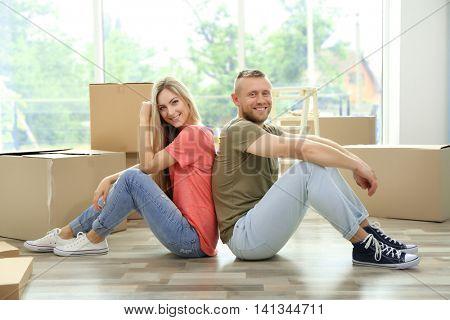 Beautiful couple sitting on wooden floor