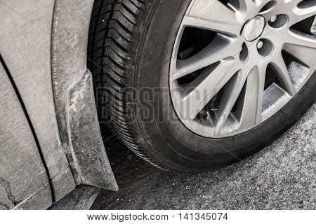Car Wheel With Dirt On Country Road