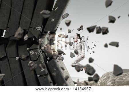 Businesswoman crashing bricks . Mixed media