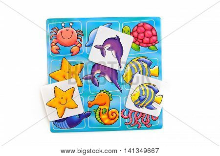 Lotto a game for children and playing cards top view isolated on a white background. A training manual on the selection of pictures of sea creatures play or teach