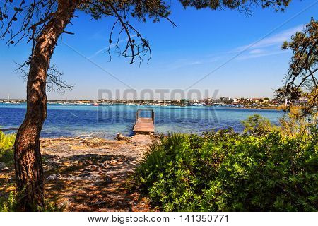 SUMMER.Ionian coast of Salento:Porto Cesareo (Lecce).- ITALY (Apulia) -In the background Porto Cesareo town seen from the Big Island Nature Reserve.