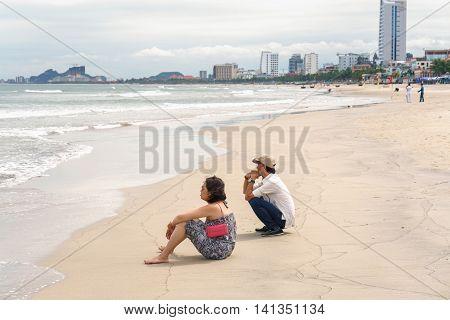 Man And Woman Looking Into Sea In China Beach Danang