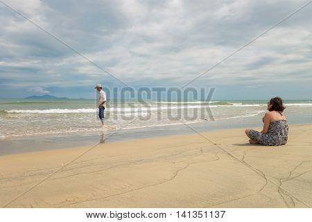 Man And Woman Looking Into Sea Of China Beach Danang