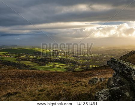 Sunset over the Twrch Valley from Craig Twrch near Sarn Helen Roman road looking towards the village of Ffarmers in the distance. Wales UK.