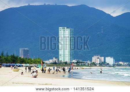 Tourists Walking At The China Beach In Danang In Vietnam