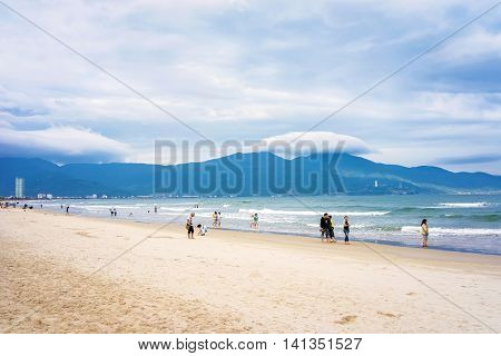 Tourists Walking Along The China Beach In Danang In Vietnam