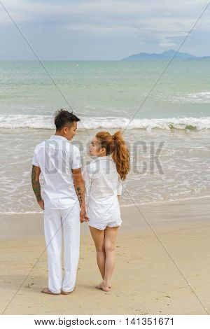 Young Couple Looking At Each Other In China Beach Danang