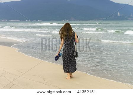 Young Girl Passing By In China Beach Of Danang