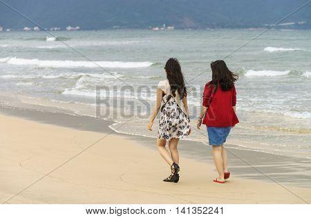 Young Girls Passing By At China Beach Of Danang