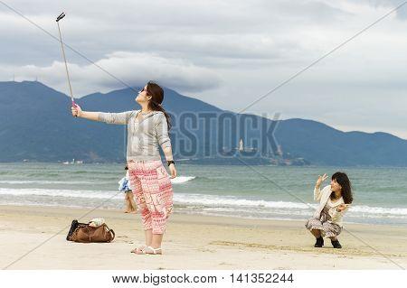 Young Woman Making Selfie In China Beach Danang