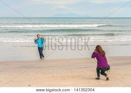Young Girls Taking Photos At China Beach Danang