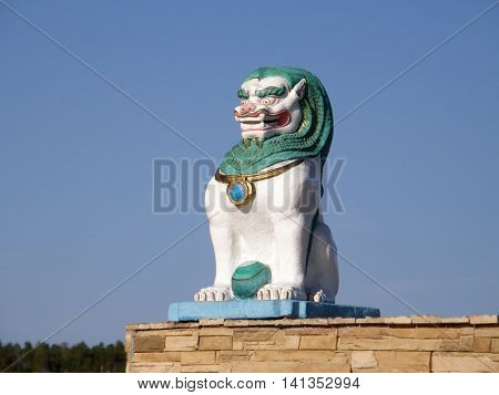 Statue of a lion on the territory of the datsan. Ulan-Ude. Buryatia. Russia