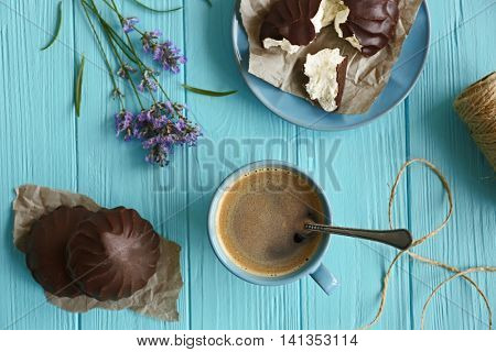 Lavender with coffee and zephyr on wooden background