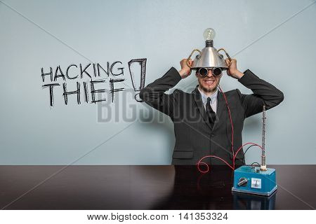 Hacking Thief text with vintage businessman and machine at office