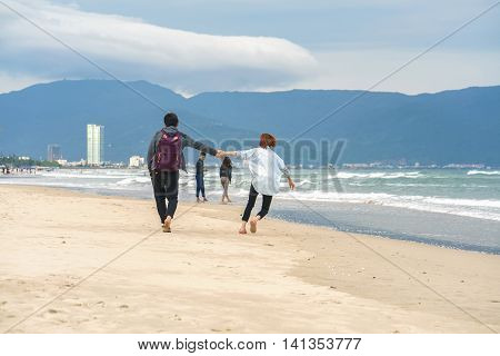 Young Couple Holding Hands At China Beach In Danang