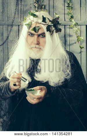Zeus god or jupiter making potion in studio