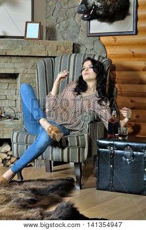 Woman Smokes An Electronic Cigarette And Drinking Whiskey