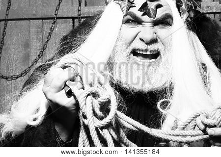Zeus god or jupiter in rope with vine crown in studio black and white