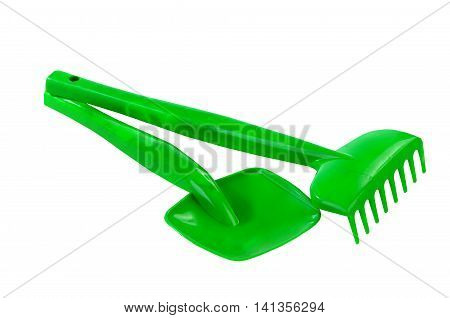 spade and rake toy isolated on white background