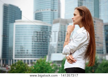 Woman Standing Near Skyscrapers