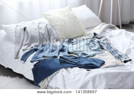 Family clothes on the bed