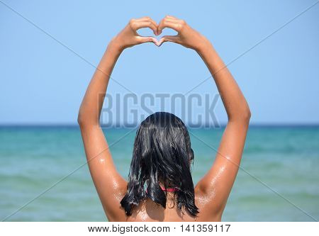 Young girl greetings gesture from the sea