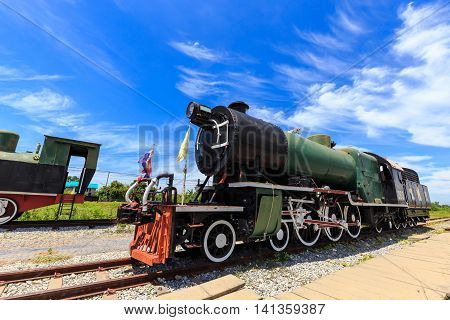 Antique Team Trains In The Station With Blue Sky Background