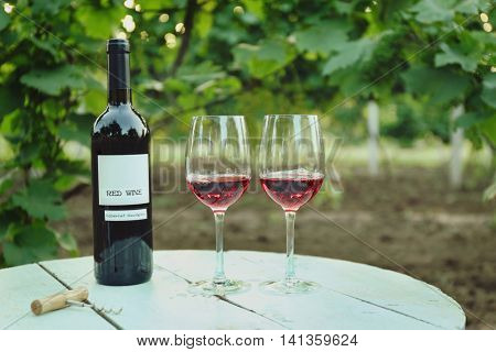 Wine on table in vineyard