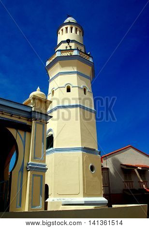 Georgetown Malaysia - January 8 2007: The unique lighthouse-style minaret at the 1808 Masjid Melayu Jamek Lebuh Aceh Pulau Pinang Mosque