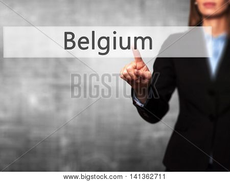Belgium - Successful Businesswoman Making Use Of Innovative Technologies And Finger Pressing Button.