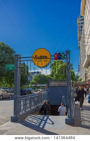 BUENOS AIRES, ARGENTINA - MAY 02, 2016: entrance to a subway station, on a sidewalk, with trees and sky as background.