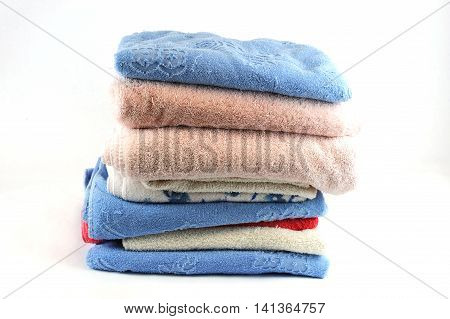 stacking bath towels isolated on white background