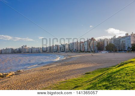 MONTEVIDEO, URUGUAY - MAY 04, 2016: la rambla is the name of the aveneu that goes through the edge of the sea, and right in front of the beach there are located some nice buildings.