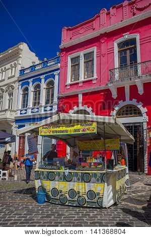 CURITIBA , BRAZIL - MAY 12, 2016: little food stand located in front of a beautifull red house.