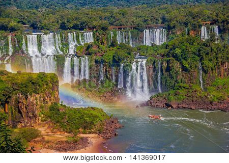 IGUAZU, BRAZIL - MAY 14, 2016: nice view of the waterfalls from the brazilian side, a boat is sailing at the bottom of the waterfalls.