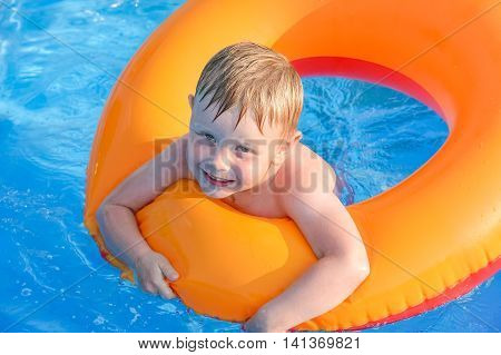 Little Boy On An Inflatable Circle In The Water