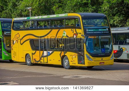 IGUAZU, BRAZIL - MAY 14, 2016: side and frot view of a tourism bus parked in the national park of iguazu.